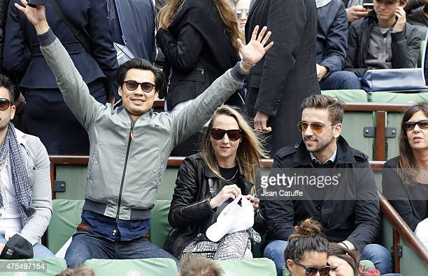 Frederic Chau Audrey Lamy and her boyfriend Thomas Sabatier attend day 8 of the French Open 2015 at Roland Garros stadium on May 31 2015 in Paris...