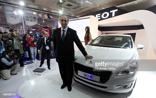 Frederic Fabre MD PCA Motors Private Ltd poses with a 508 during the 11th Auto Expo 2012 at Pragati Maidan on January 5 2012 in New Delhi India The...