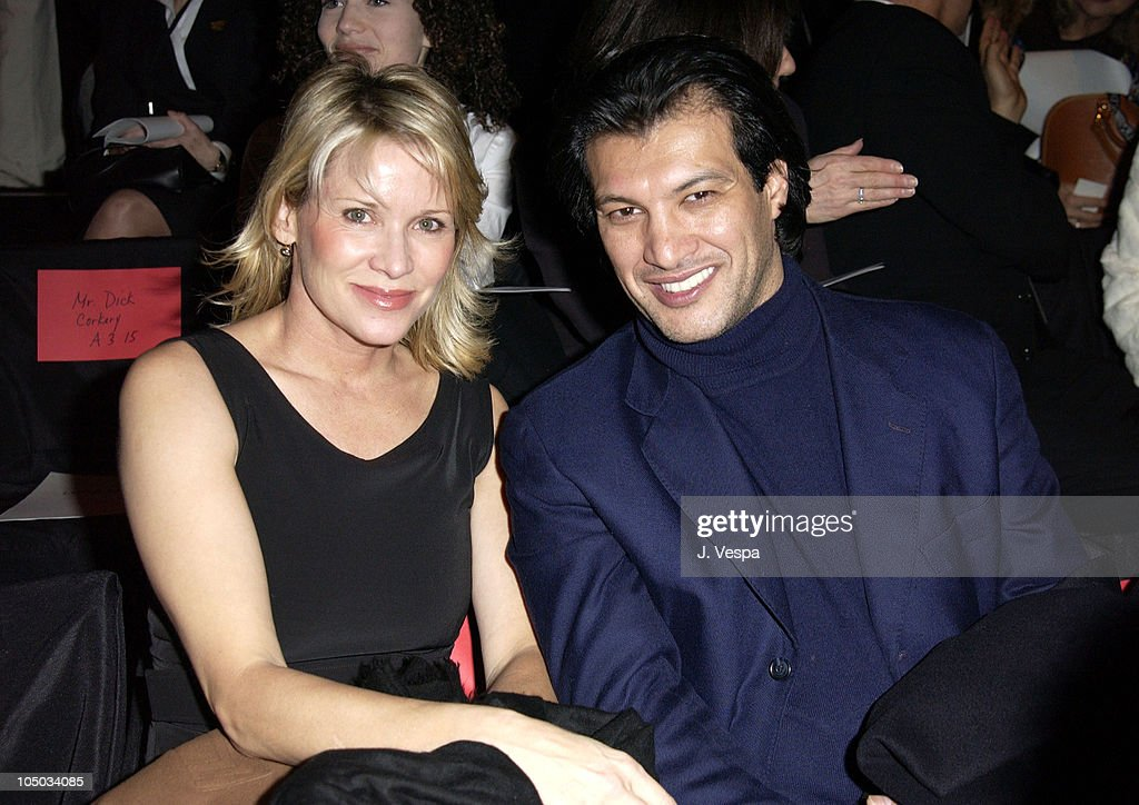 Frederic Fekkai and guest during Mercedes Benz Fashion Week Fall 2003 Collections - Luca Luca - Front Row at Bryant Park in New York City, New York, United States.