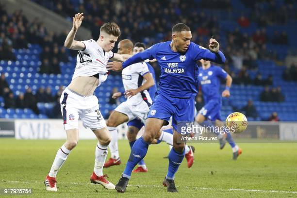 Frederic Gounongbe of Cardiff City is marked by Reece Burke of Bolton Wanderers during the Sky Bet Championship match between Cardiff City and Bolton...