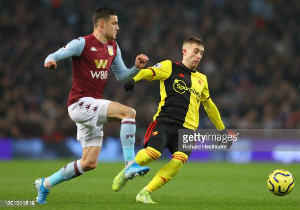 Frederic Guilbert of Aston Villa battles for possession with Gerard Deulofeu of Watford during the Premier League match between Aston Villa and...