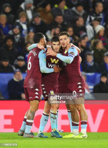 Frederic Guilbert of Aston Villa celebrates scoring the opening goal with team-mates Jack Grealish and Douglas Luiz during the Carabao Cup Semi Final...