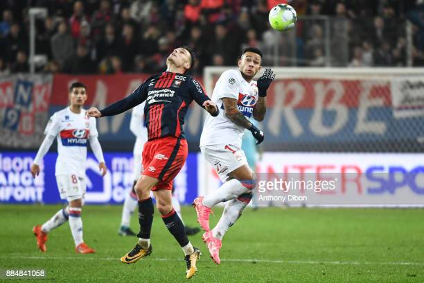 Frederic Guilbert of Caen and Memphis Depay of Lyon during the Ligue 1 match between SM Caen and Olympique Lyonnais at Stade Michel D'Ornano on...