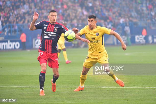 Frederic Guilbert of Caen and Yuri Berchiche of PSG during the Ligue 1 match between SM Caen and Paris Saint Germain at Stade Michel D'Ornano on May...