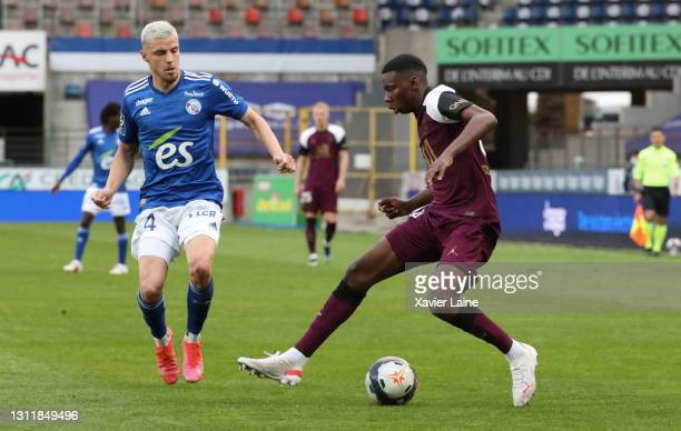 Frederic Guilbert of Strasbourg in action with Kenny Nagera of Paris Saint-Germain during the Ligue 1 match between Strasbourg and Paris at Stade de...