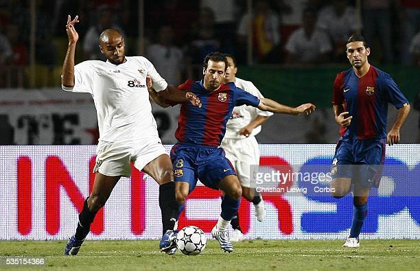 Frederic Kanoute and Ludovic Giuly during the 2006 UEFA Super Cup match between FC Barcelona and Sevilla FC