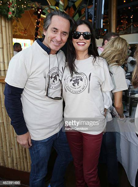 Frederic Marq and Adriana de Moura participate in Gloria Emilio Estefan Host 6th Annual Thanksgiving Day Feed A Friend Event at Bongos Cuban Cafe at...