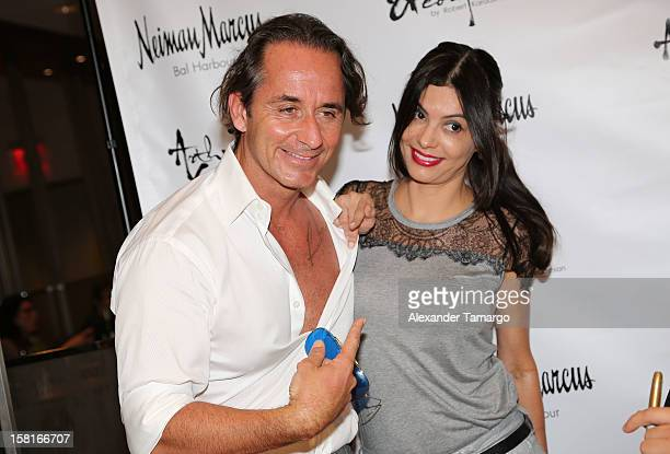 Frederic Marq and Adriana de Moura pose during the Arthur George Socks Collection presentation at Neiman Marcus Bal Harbour at Neiman Marcus on...