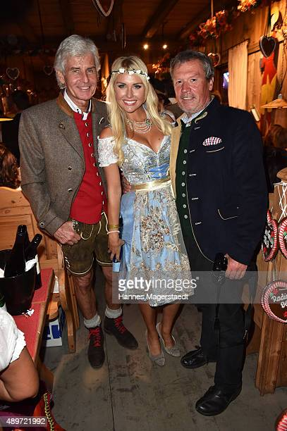 Frederic Meisner Denise Cotte and Hansi Kraus attend the Radio Gong 963 Wiesn at Weinzelt during the Oktoberfest 2015 on September 23 2015 in Munich...