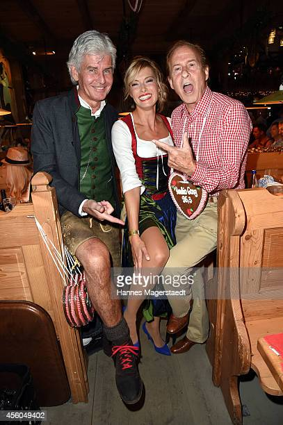 Frederic Meisner Sarah Winkhaus and Michael Holm attend the Radio Gong 963 Wiesn at Weinzelt during Oktoberfest at Theresienwiese on September 24...