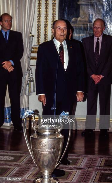 Frederic MITTERRAND french president with the trophy during a reception for the Champions League champions at the Elysee June 03 1993 in Paris France