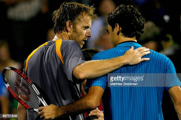 Frederic Niemeyer of Canada congratulates Roger Federer of Switzerland after their match during the Rogers Cup at Uniprix Stadium on August 11, 2009...
