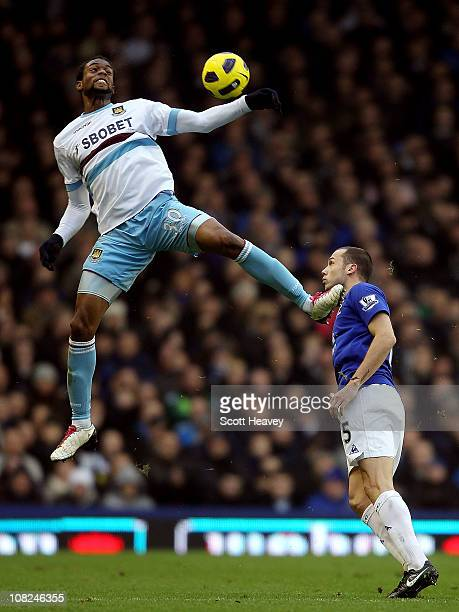 Frederic Piquionne of West Ham in action with John Heitinga of Everton during the Barclays Premier League match at Goodison Park on January 22 2011...