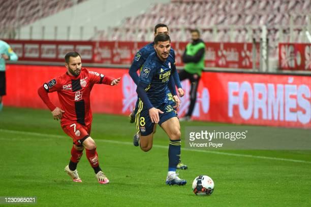 Frederic SAMMARITANO of Dijon and Houssem AOUAR of Lyon during the Ligue 1 soccer match between Dijon and Olympique Lyonnais at Gaston Gerard stadium...