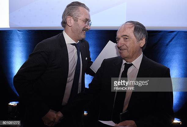 Frederic Thiriez president of the Professionnal French Football league shakes hands with the president of the French Football Federation Noel Le...