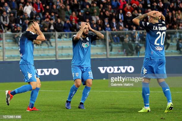 Frederic Veseli Francesco Caputo and Antonino La Gumina of Empoli FC gestures during the Serie A match between Empoli and Bologna FC at Stadio Carlo...