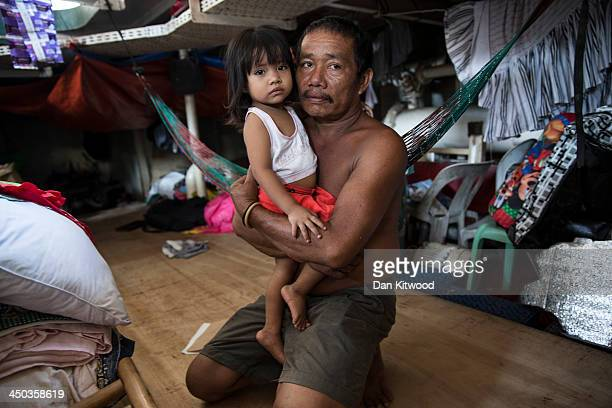 Frederica Opriasa and his daughter Yesha Annica Mae Opriasa 2 pose for a picture in their makeshift sleeping area in the hull of a tanker that ran...
