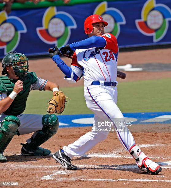 Frederich Cepeda of Cuba crushes a one-run home run as Kyle Botha catcher of South Africa looks during the 2009 World Baseball Classic Pool B match...