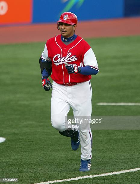 Frederich Cepeda of Cuba rounds the bases after hitting a three run home run against Venezuela during their game at the second round of the World...