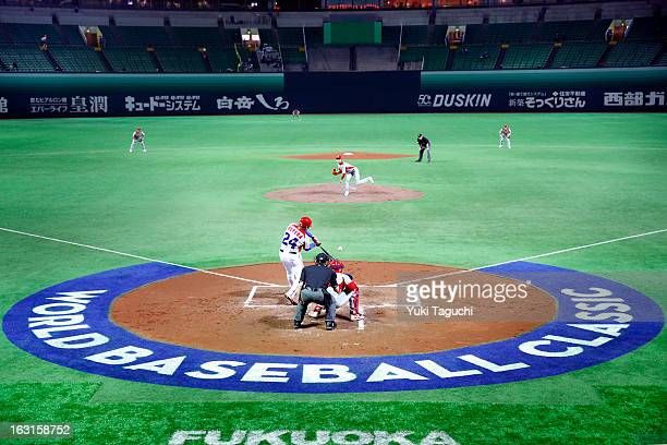 Frederich Cepeda of Team Cuba hits a RBI triple in the bottom of the first inning during Pool A Game 4 between Team China and Team Cuba during the...