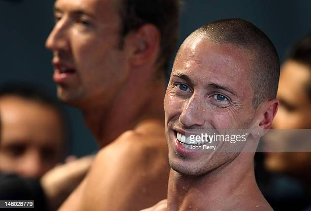 Frederick Bousquet of France and Alain Bernard of France speak to members of the media after the men's 50m freestyle final at the 2012 Open EDF de...