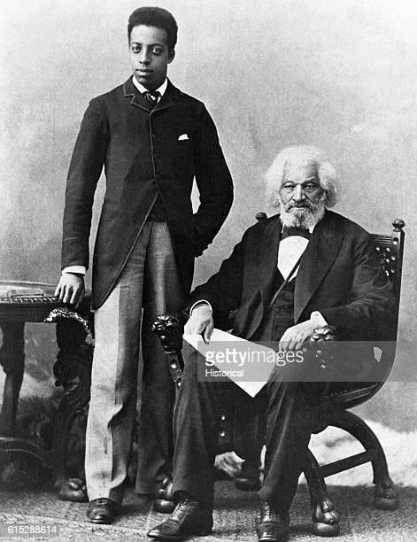 Frederick Douglass seated poses with his grandson Joseph Douglass an escaped slave educated himself and was one of the foremost writers and...