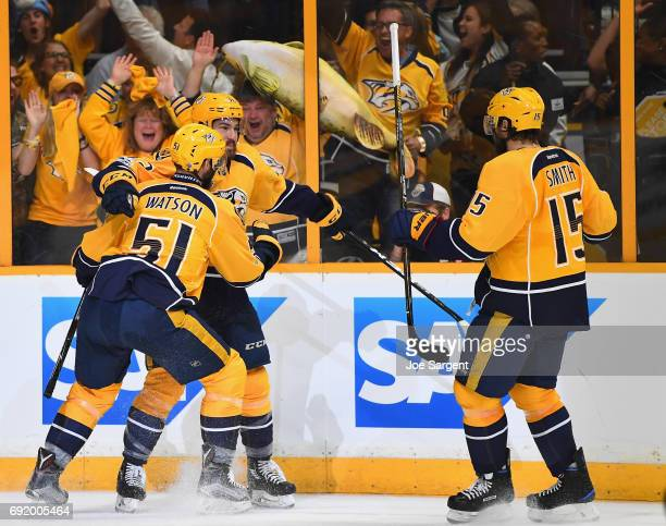 Frederick Gaudreau of the Nashville Predators celebrates his goal with teammates Craig Smith and Austin Watson during the second period of Game Three...