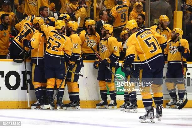 Frederick Gaudreau of the Nashville Predators celebrates with his teammates after scoring a goal against Matt Murray of the Pittsburgh Penguins...
