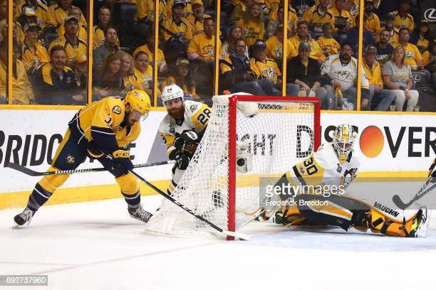 Frederick Gaudreau of the Nashville Predators scores a goal against Matt Murray of the Pittsburgh Penguins during the second period in Game Four of...