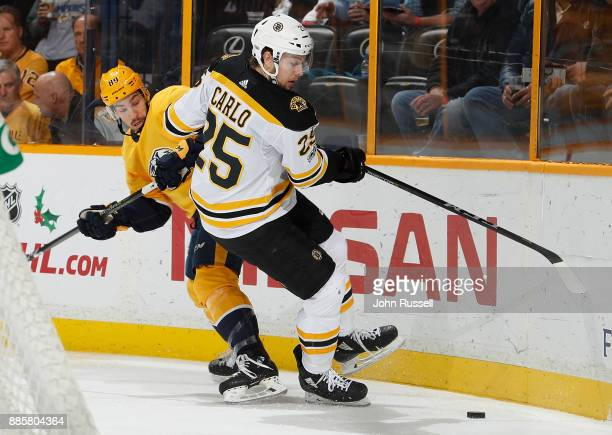 Frederick Gaudreau of the Nashville Predators skates against Brandon Carlo of the Boston Bruins during an NHL game at Bridgestone Arena on December 4...