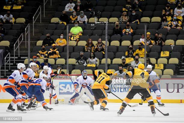 Frederick Gaudreau of the Pittsburgh Penguins scores a goal in the first period against the New York Islanders in Game One of the First Round of the...
