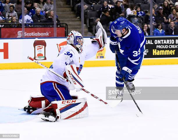 Frederick Gauthier of the Toronto Marlies jumps in front of goalie Zachary Fucale of the Laval Rocket during AHL game action on March 12 2018 at Air...