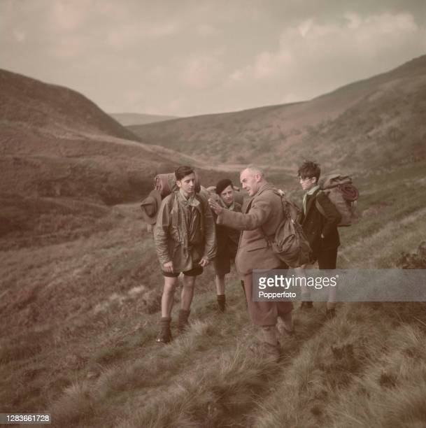 Frederick Heardman of the Edale Moutain Rescue Team gives advice to ramblers setting out for a walk along the Pennine Way in the Peak District near...