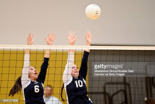 Frederick High School's Alexis Dominguez and Sabrina Duey jump to block a shot from Mead High School during a match Thursday Sept 5 at Frederick