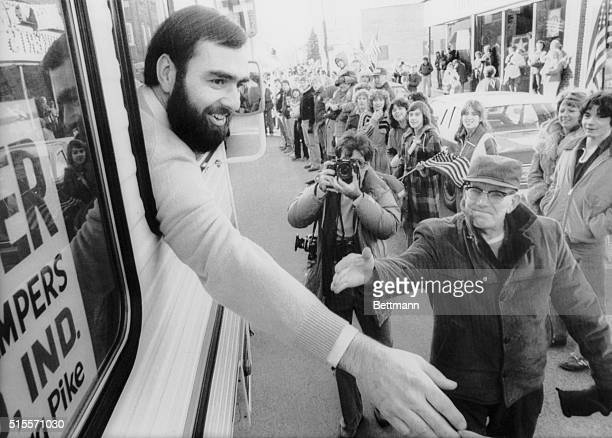 Frederick Lee Kupke reaches out from the window of a van to greet the people who turned out to welcome him home following his release from Tehran |...