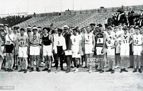Frederick Lorz lines up with eventual race winner Thomas Hicks of the United States and the other competitors before the start of the Olympic...