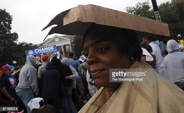 Fredericksburg VA Natalie Wright of Fredericksburg seeks shelter under a cardboard box as it rained while waiting for Presidential Democratic nominee...