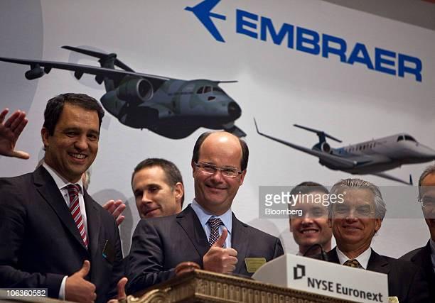 Frederico Curado president and chief executive officer of Empresa Brasileira de Aeronautica SA center participates in the closing bell ceremony at...