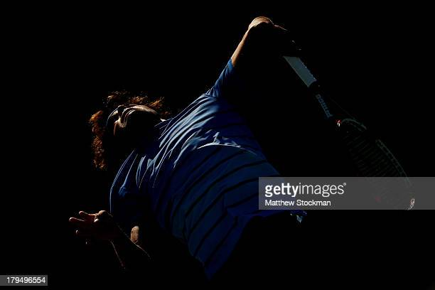 Frederico Ferreira Silva of Portugal serves next to his partner Quentin Halys of France during their boys' doubles second round match against...
