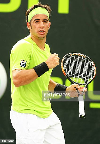 Frederico Gil of Portugal celebrates a point against Ivo Karlovic of Croatia during day six of the Sony Ericsson Open at the Crandon Park Tennis...