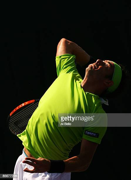 Frederico Gil of Portugal serves against Ivo Karlovic of Croatia during day six of the Sony Ericsson Open at the Crandon Park Tennis Center on March...