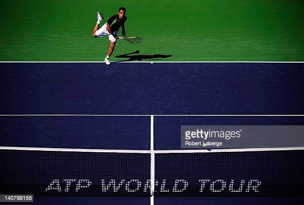 Frederico Gil of Portugal serves to Alex Kuznetsov of the USA at the BNP Paribas Open at the Indian Wells Tennis Garden on March 6, 2012 in Indian...