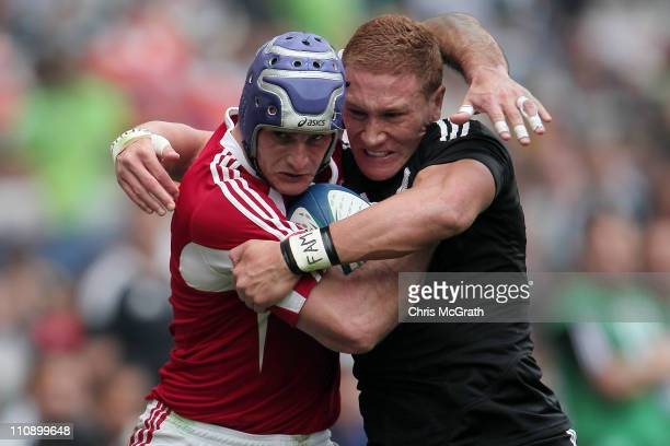 Frederico Oliveira of Portugal is tackled by Declan O'Donnell of New Zealand during day two of the IRB Sevens at Hong Kong Stadium on March 26, 2011...