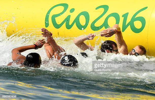 Frederico Vanelli of Italy and Allan Do Carmo compete in the Men's 10km Marathon Swim on Day 11 of the Rio 2016 Olympic Games at Fort Copacabana on...
