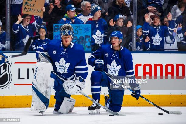 Frederik Andersen and Auston Matthews of the Toronto Maple Leafs wear jersey's honouring Leafs legend Johnny Bower during warmup before facing the...