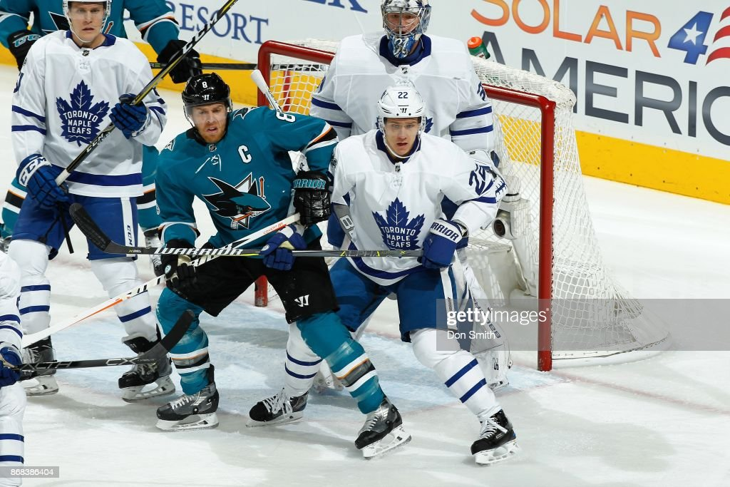 Frederik Andersen #31 and Nikita Zaitsev #22 of the Toronto Maple Leafs defend Joe Pavelski #8 of the San Jose Sharks at SAP Center on October 30, 2017 in San Jose, California.