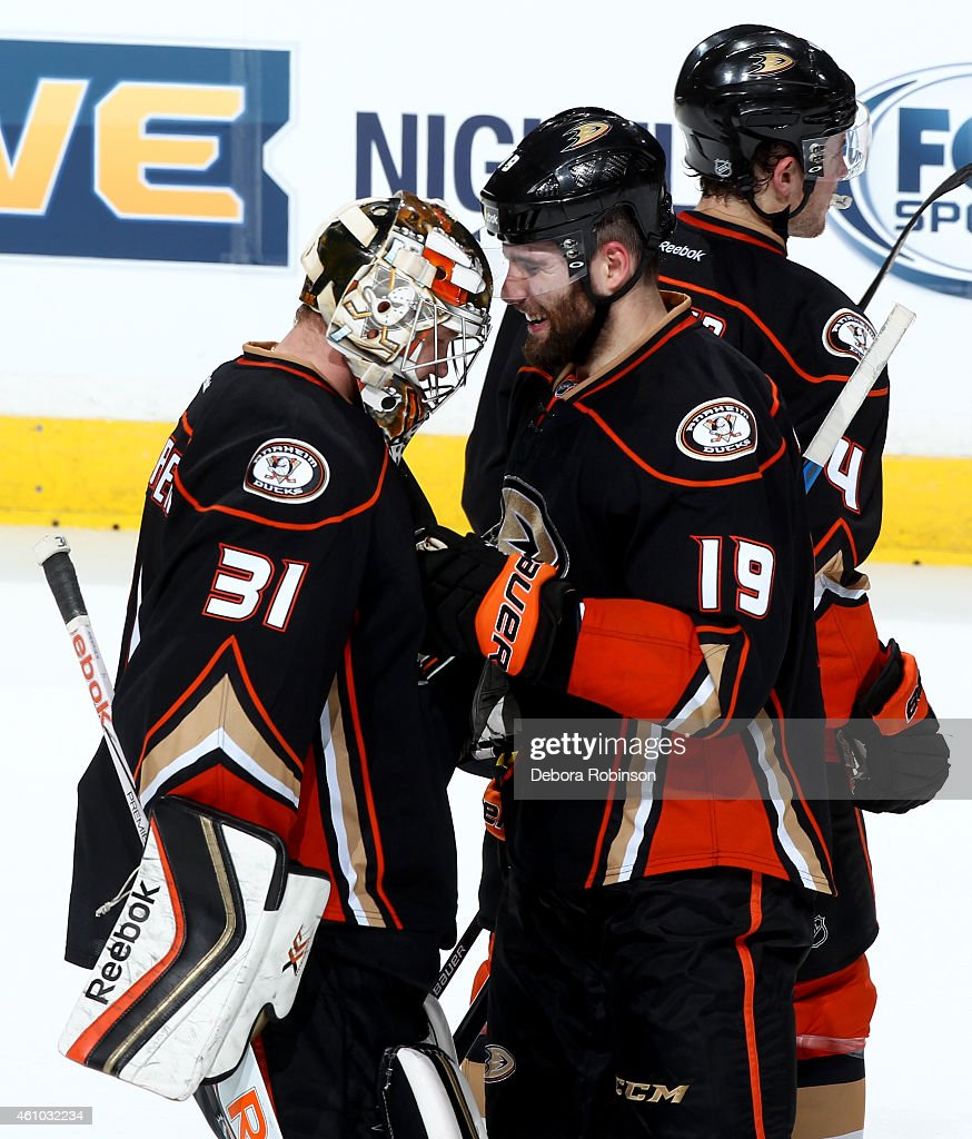 Frederik Andersen #31 and Patrick Maroon #19 of the Anaheim Ducks celebrate the Ducks' 4-3 shootout win against the Nashville Predators on January 4, 2015 at Honda Center in Anaheim, California.