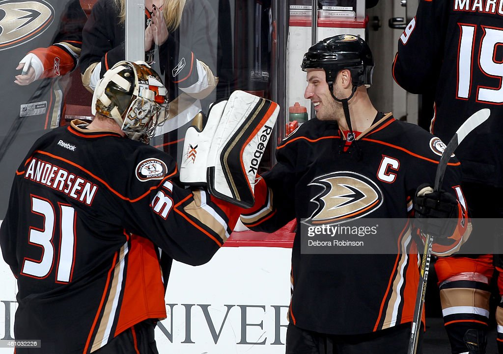 Frederik Andersen #31 and Ryan Getzlaf #15 of the Anaheim Ducks celebrate the Ducks' 4-3 shootout win against the Nashville Predators on January 4, 2015 at Honda Center in Anaheim, California.