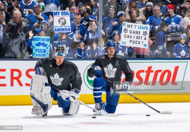 Frederik Andersen Auston Matthews of the Toronto Maple Leafs wears a jersey honouring the Canadian Armed Forces during warmup before facing the...