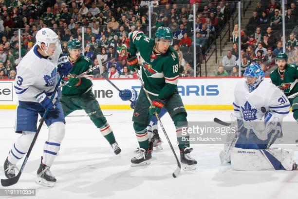 Frederik Andersen makes a save while his teammate Justin Holl of the Toronto Maple Leafs defends against Jordan Greenway and Joel Eriksson Ek of the...